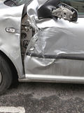Car Damage. Crushed Door Damage at Silver Car Royalty Free Stock Image