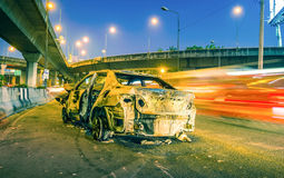 Car damaged by fire in accident clash Royalty Free Stock Photography