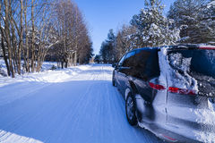 Car on a dangerous road, snow and ice. Royalty Free Stock Photos