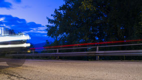 Car on the darkness road. With light stripes Stock Image
