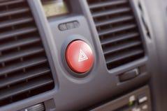 Car Dash. A car dashboard, narrow depth field focusing on the hazard-warning button Royalty Free Stock Photos