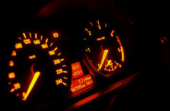 Car dashboard. With focus on consumption indicator display royalty free stock photo