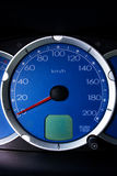 Car dashboard. Car blue dashboard with a red pointer Royalty Free Stock Image
