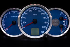 Car dashboard. With a red pointers Royalty Free Stock Photos