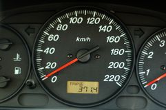 Car dashboard. A close up of car dashboard with speed over black background Royalty Free Stock Image