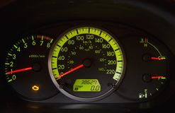 Car dashboard. Engine trouble lights is illuminated in dashboard of running car (trouble light easily cloned out as well royalty free stock image