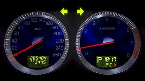 Car dashboard. Blue dials for the odometer and tachometer. Hazard lights turned on royalty free stock photo