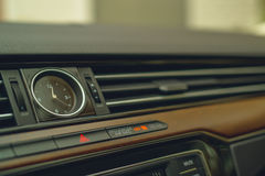 Car dashboard clock. Wood and plastic background Stock Photography
