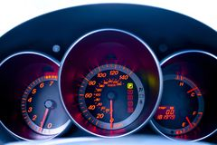 Car dashboard closeup. With blue and red lights stock image