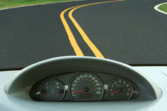 Car dashboard and curvy road. A Car dashboard and curvy road stock photos