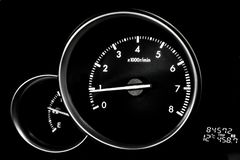 Car dashboard dials - engine RPM rotations per minute. On black background royalty free stock images