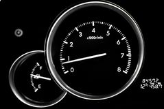 Car dashboard dials - engine RPM rotations per minute. On black background royalty free stock photo