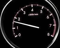 Car dashboard dials - engine RPM rotations per minute. Isolated on black background stock photography