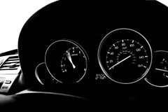 Car dashboard dials - engine RPM and speedometer. In black and white stock photography