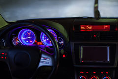 Car dashboard. With digital tachometers and steering wheel commands Stock Images
