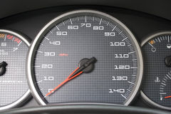 Car Dashboard Gauges. A closeup of a modern car interior - the dashboard. This is the drivers cockpit Stock Photo