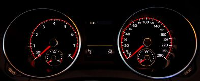 Car dashboard gauges. Car digital dashboard gauges illuminated Stock Image