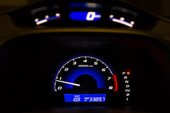 Car Dashboard with Illuminated Tachometer and Speedometer, HDR. Stock Photography