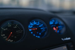 Car dashboard with neon lights. Car dashboard tuning turbo neon and led lights Stock Photos