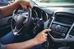 Car dashboard. Radio closeup. Man sets radio stock photo