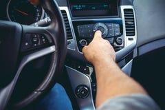 Car dashboard. Radio closeup. Man sets radio royalty free stock photo