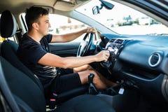 Car dashboard. Radio closeup. Young man Man sets radio while drive car royalty free stock photos