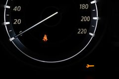 Car Dashboard showing the seat belt warning light. royalty free stock photography
