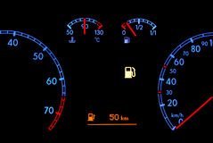 Car dashboard shows low fuel. In the night Stock Image