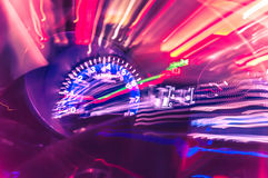Car dashboard with speedometer on a blurred background. Speed lights, allusion to Speed Royalty Free Stock Photos