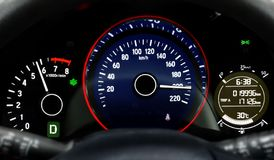 Car dashboard speedometer moving in high speed. Dashboard of a car speedometer moving in high speed Stock Images