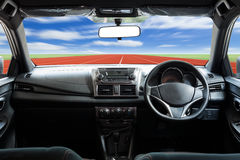 Car dashboard speeds while on the road Royalty Free Stock Photo