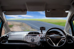 Car dashboard speeds while on the road Stock Photo