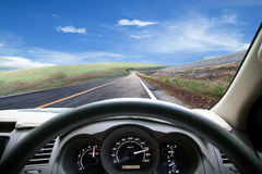 Car dashboard speeds while on the road. car driving fast. Royalty Free Stock Photography
