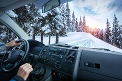 Car dashboard and steering wheel inside of car. Winter landscape. Travel concepte stock photos