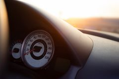 Car dashboard with sunset or sunrise.  stock photos