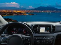Car dashboard traveling to Naples. View of a car dashboard with a navigation unit traveling to Naples royalty free stock photography