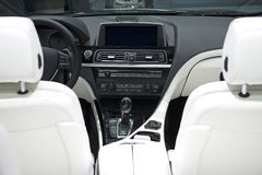 Car Dashboard With White Leather Seats Stock Photo