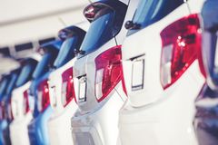 Car Dealer Business Concept. Row of Brand New Compact Cars on the Dealer Lot. Transportation Industry Royalty Free Stock Photo