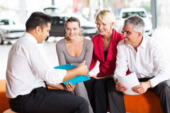 Car dealer explaining contract Royalty Free Stock Photos