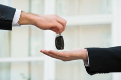 Car Dealer Giving Keys To Businessman Royalty Free Stock Photos