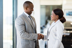 Car dealer handshake customer Royalty Free Stock Photos