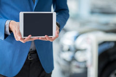 Car dealer holding pc tablet Royalty Free Stock Photography