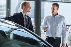 Car dealer showing vehicle Stock Image