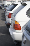 Car dealership 3. Row of brand new cars at dealership lot Royalty Free Stock Photos