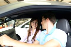 Car dealership advice - sellers and customers when buying a car stock photo