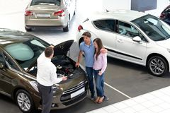 Car dealership advice - sellers and customers when buying a car stock photography