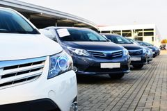 Car dealership - many vehicles parked for sale in a row royalty free stock images