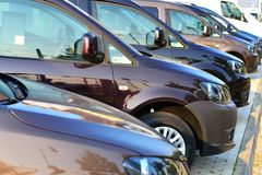 Car dealership - many vehicles parked for sale in a row royalty free stock photography