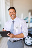 Car dealership salesman Stock Image