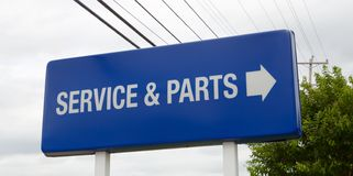 A Car dealership service and parts sign. Service and parts department sign at an automotive car dealership Royalty Free Stock Photography